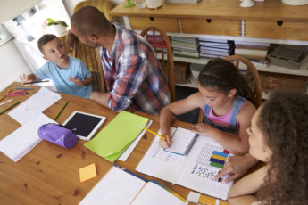 Family homeschooling at the kitchen table