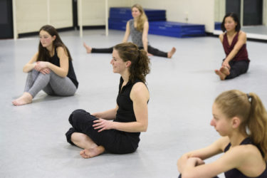 Dancers ask questions during the cool-down period at the end of the class.