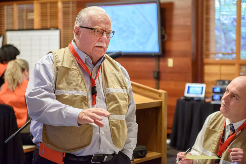 Larry Gibbs participates in an earthquake preparedness drill in 2016.