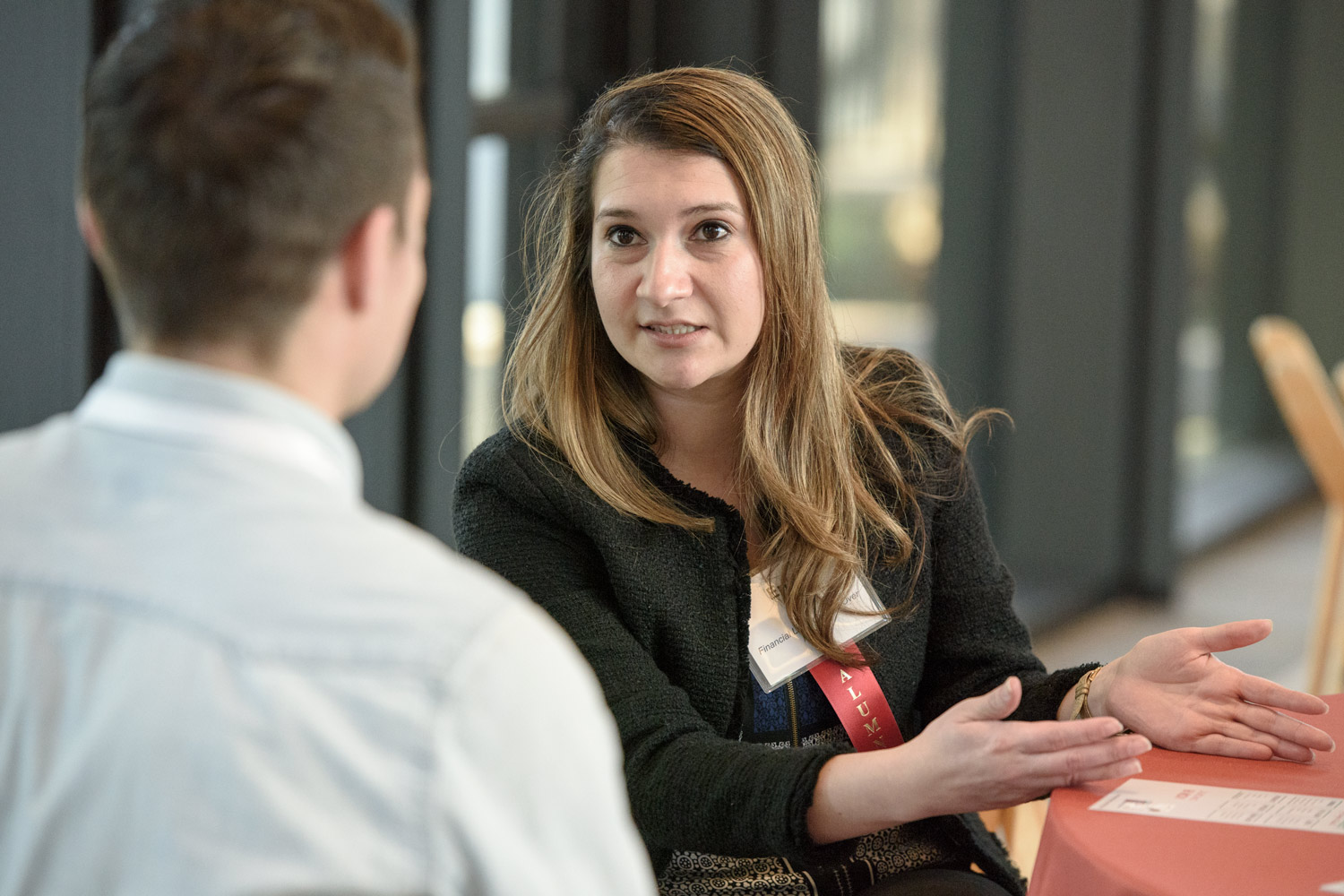Erika Topete meets with a prospective graduate student at a recent event on financial literacy..