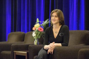 Judy Logan sitting next to a bouquet