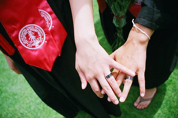 Chrysanthe Tan ('09), left, and Alexis Ortega ('09) show off their Equality rings at Commencement.