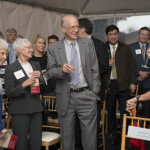 Barbara Hastorf and Janice Rosse, the widows of two of Stanford's former provosts, stand with Kennedy during a toast.