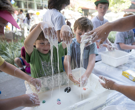 Brothers Reid and Quinn Adams experimented with the quicksand made of cornstarch and water at Bio-X Kids' Science Day. (Photo: Linda Cicero)