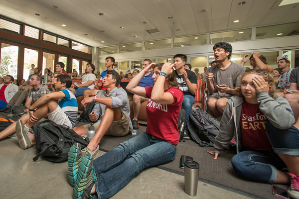 A group of World Cup soccer fans assembled at the large monitor in Y2E2 Tuesday, July 1, to watch the U.S. team play Belgium in an elimination round. The U.S. battled but fell to Belgium 2-1 with all the goals scored in extra time. (Photo: Linda A. Cicero / Stanford News Service)