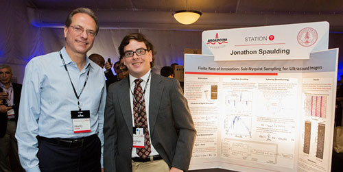 Henry Samueli, co-founder, chairman of the board and chief technical officer of Broadcom, with  Stanford graduate student Jonathon Spaulding