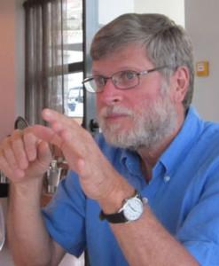 Photo of Aharon Kapitulnik making hand gestures