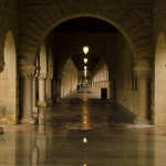 On a dark and stormy day, the arcades in the Main Quad are bathed in light.