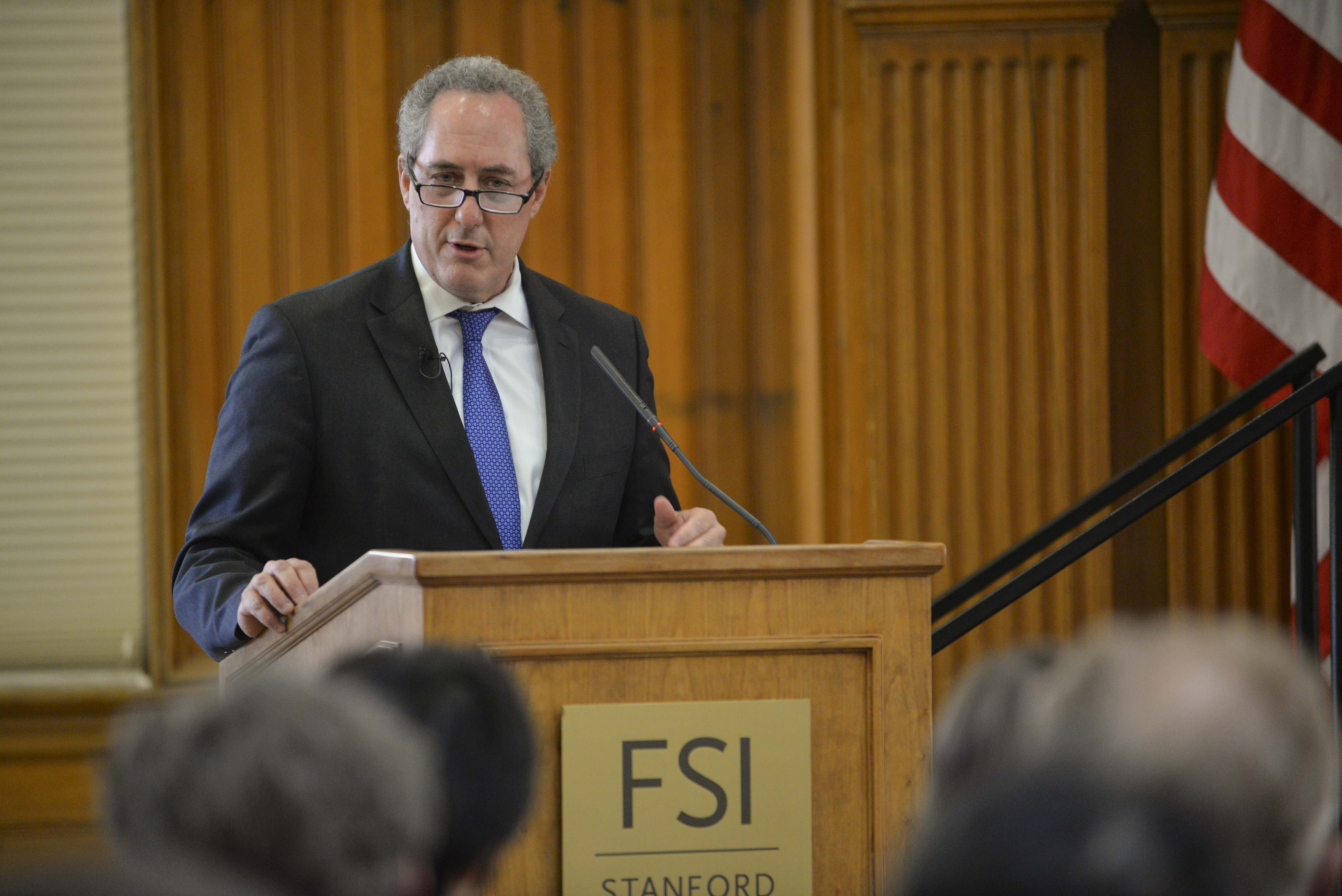 Photo of Michael Froman speaking at a lectern that has an FSI placard.