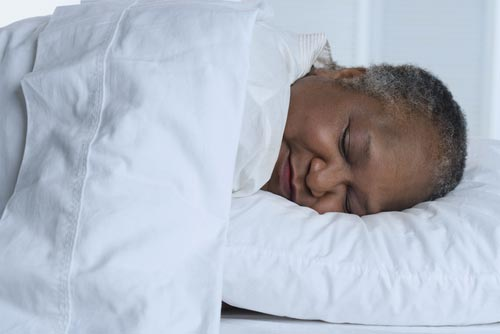 elderly person sleeping