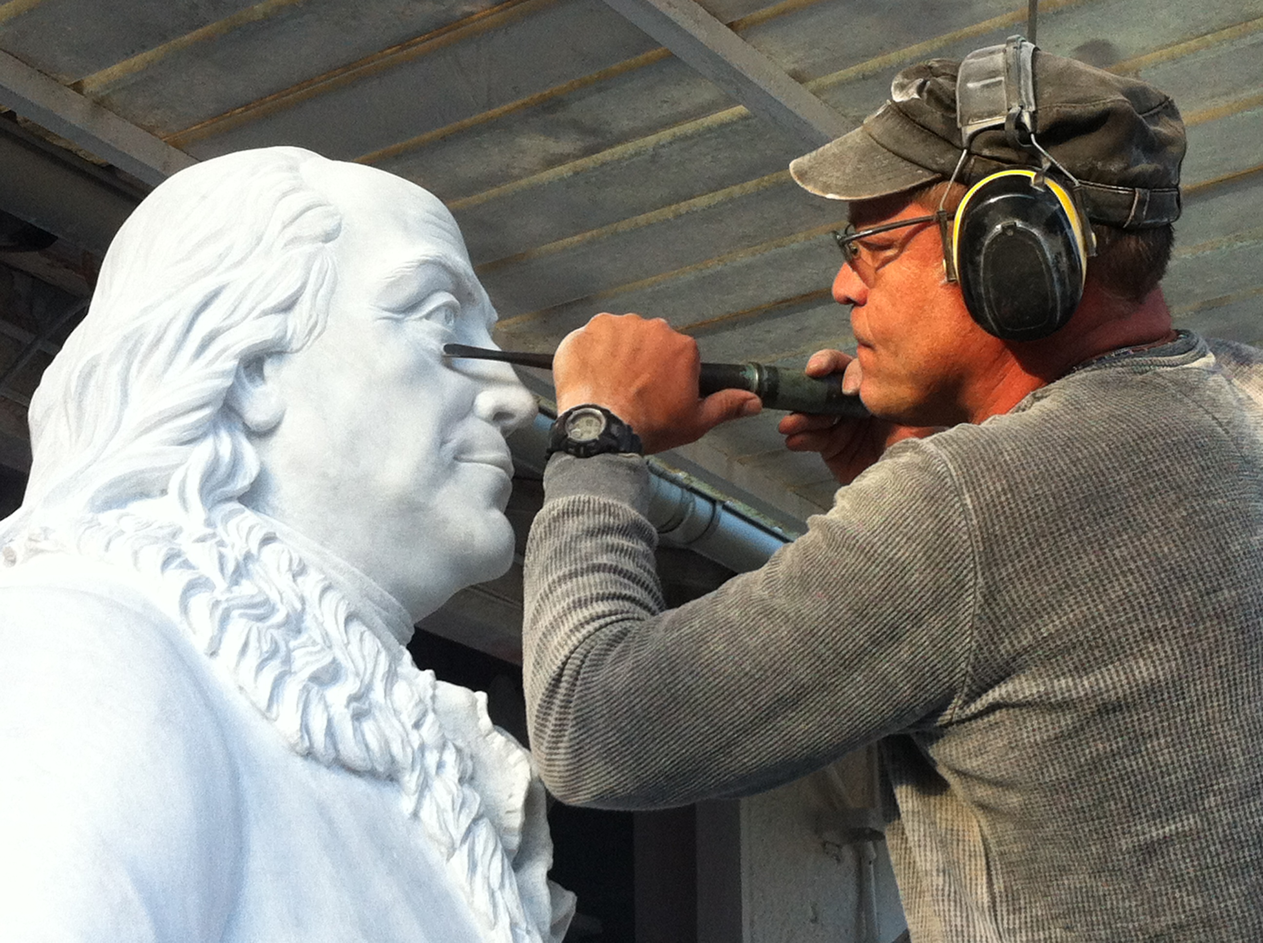 Sculptor Oleg Lobykin works on the marble statue of Benjamin Franklin. (Photo courtesy Oleg Lobykin)