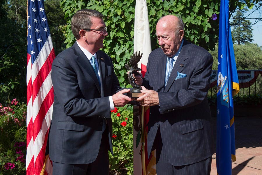 U.S. Secretary of Defense Ashton Carter presents former Secretary of State George Shultz with the Innovators in Defense, Enterprise, Academia and Science (IDEAS) award during a campus ceremony  May 11. (Photo by Senior Master Sgt. Adrian Cadiz/U.S. Department of Defense.)