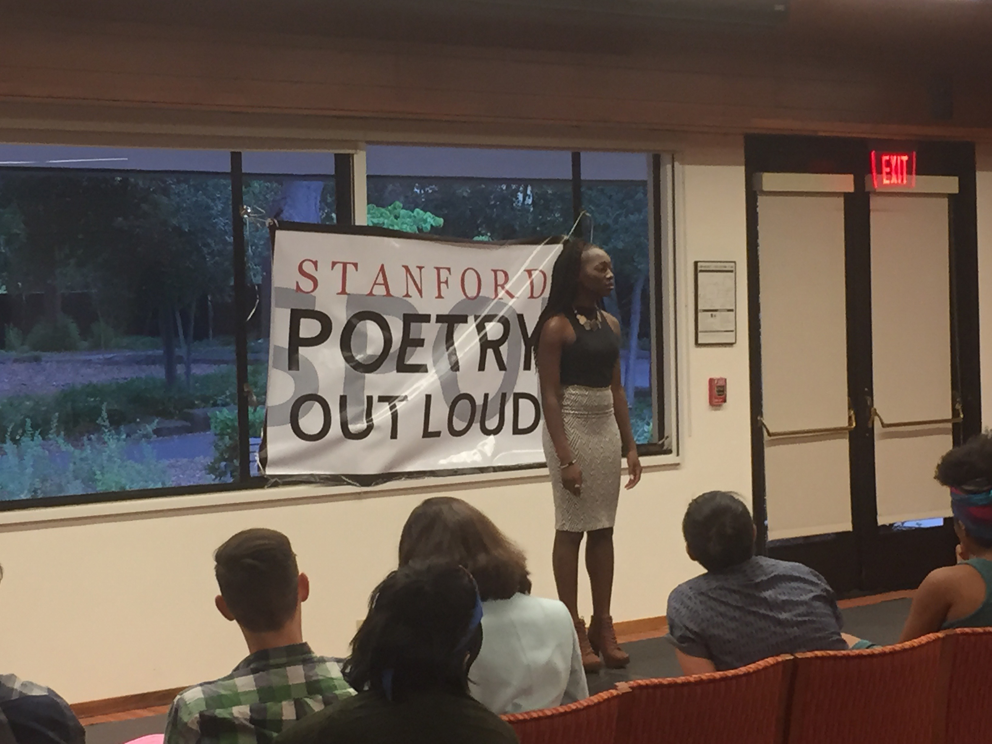 "Abisola Kusimo, the winner of the 2016 Stanford Poetry Out Loud competition, performs Margaret Walker's poem ""For My People."" (Photo credit: Justin Tackett)"