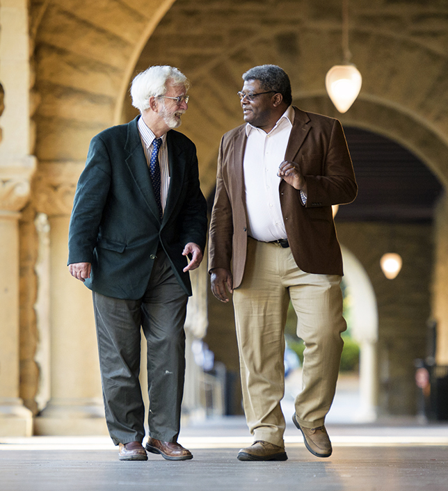 Philosophy professors John Perry and Ken Taylor walk the talk in the arcades of the Main Quadrangle at Stanford University.