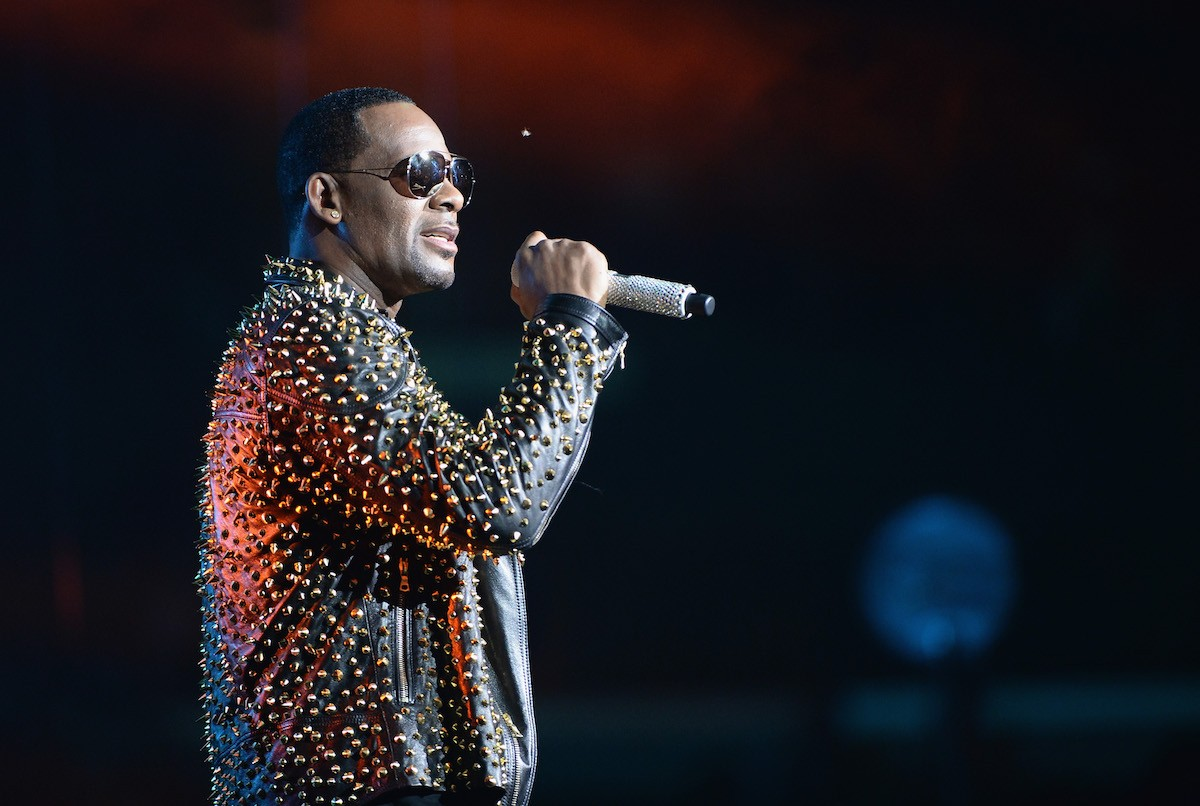 r kelly spotify playlist removal hate content abuse allegations