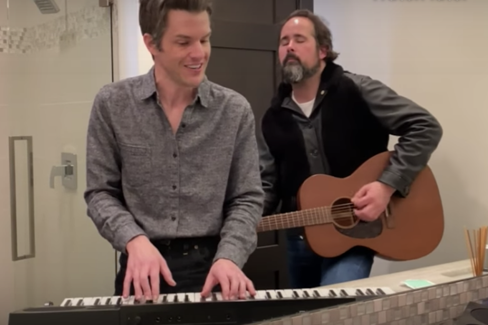 The Killers play 'Caution' in the bathroom