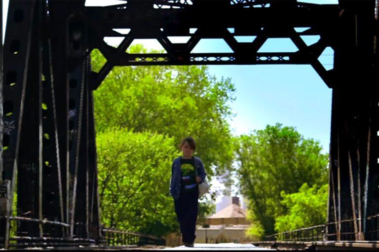 Semisonic You're Not Alone video still of boy walking across a bridge