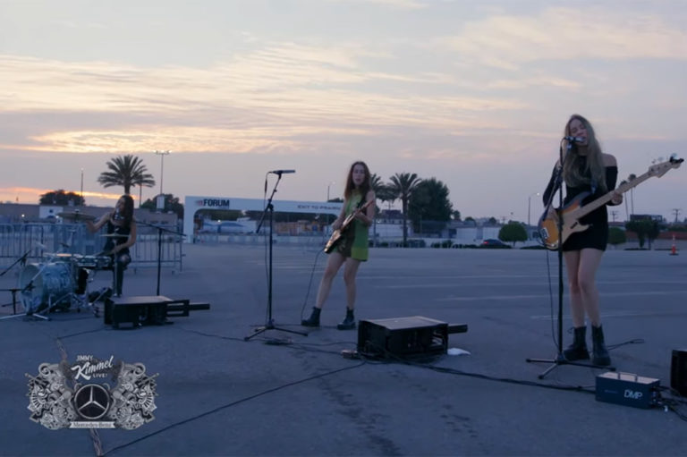 Haim performing in The Forum Parking Lot