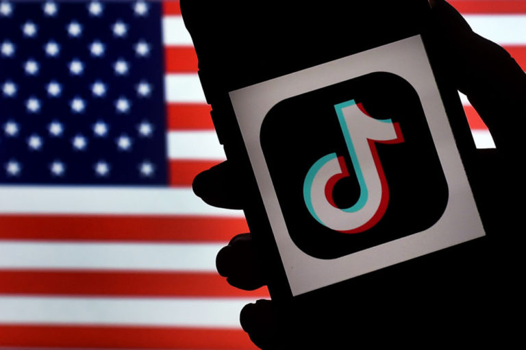 Tik Tok app in front of the U.S. Flag