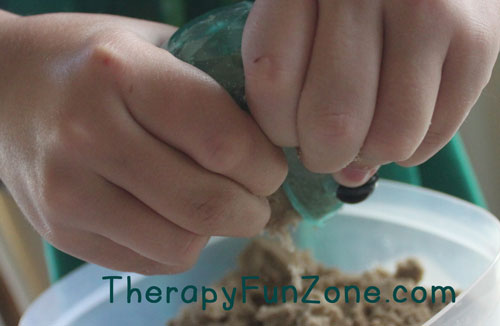 spitting-out-kinetic-sand
