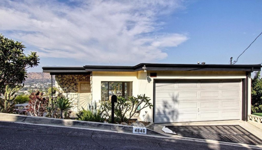 Perched on a breathtaking hilltop, with 180 degree views of Glendale, Eagle Rock, Highland Park, Glassell Park and Mt. Washington, this mid-century home is straight out of a classic film