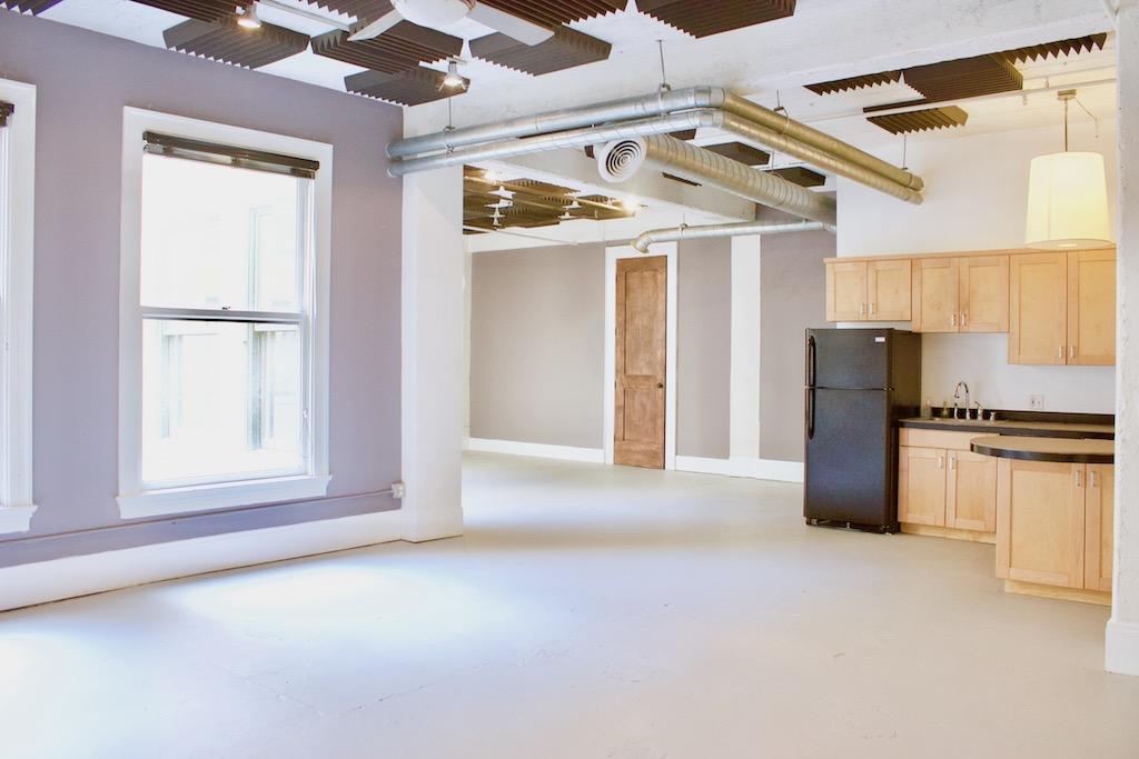 BRIGHT & AIRY HIGGINS BUILDING LOFT | INTERIOR CORNER UNIT | ORIGINAL SUBWAY TILE WALL | HIGH CEILINGS | WALK-IN CLOSET