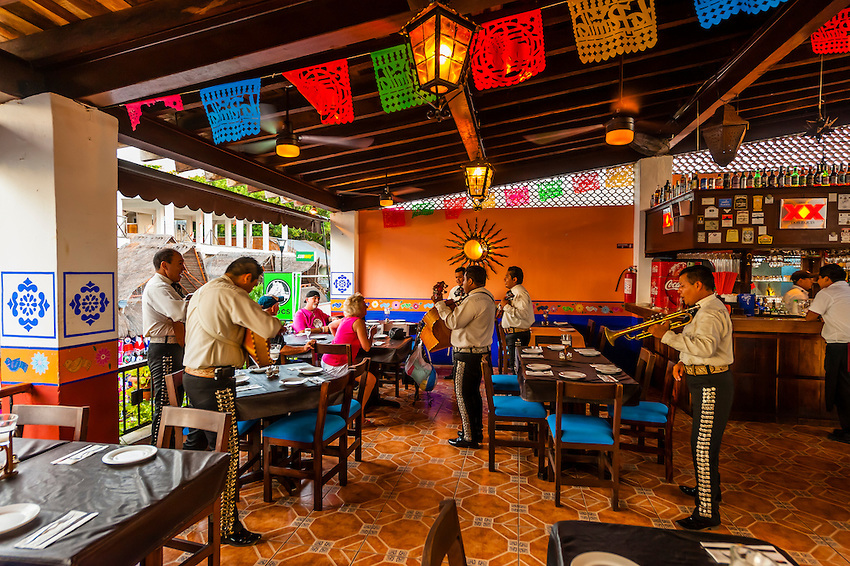 A mariachi band, La Parrilla Mexican Grill, La Quinta Avenida (5th Avenue), a pedestrian shopping street in Playa del Carmen, Riviera Maya, Quintana Roo, Mexico.