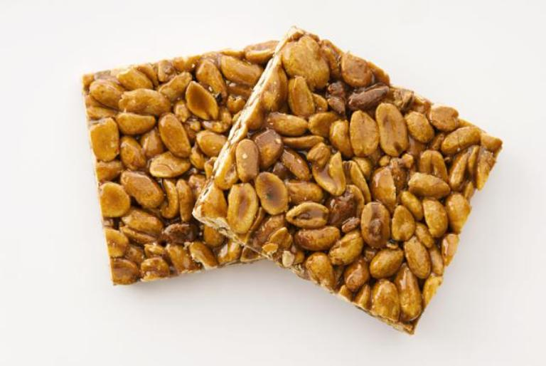 Close-up of two peanut brittles
