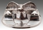A SILVERPLATED INKWELL IN THE FORM OF AN EAGLE