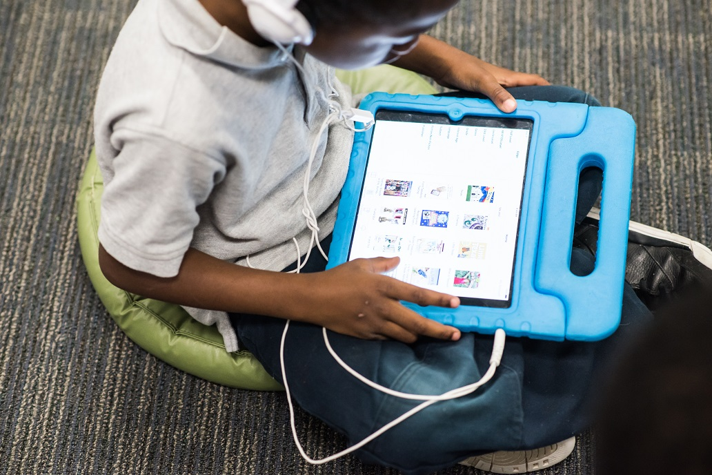 This picture shows a Roots student working on their individual playlist in order to access the material in a personalized manner.