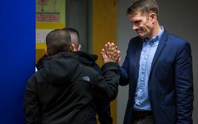 Teacher gives student high-five