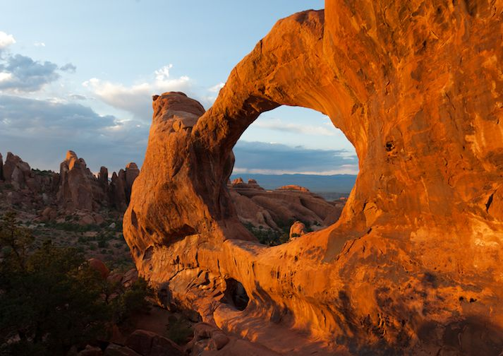 Double O Arch in the early morning sunshine in Arches National Park.