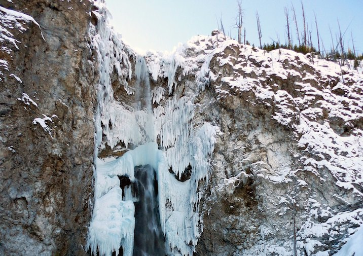 Snowy winter at Fairy Falls in Yellowstone National Park.