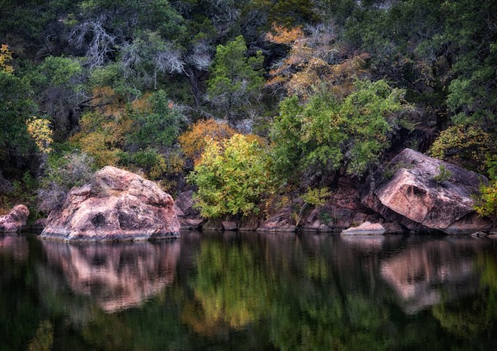 Fall reflection at Inks Lake State Park near Austin Texas.