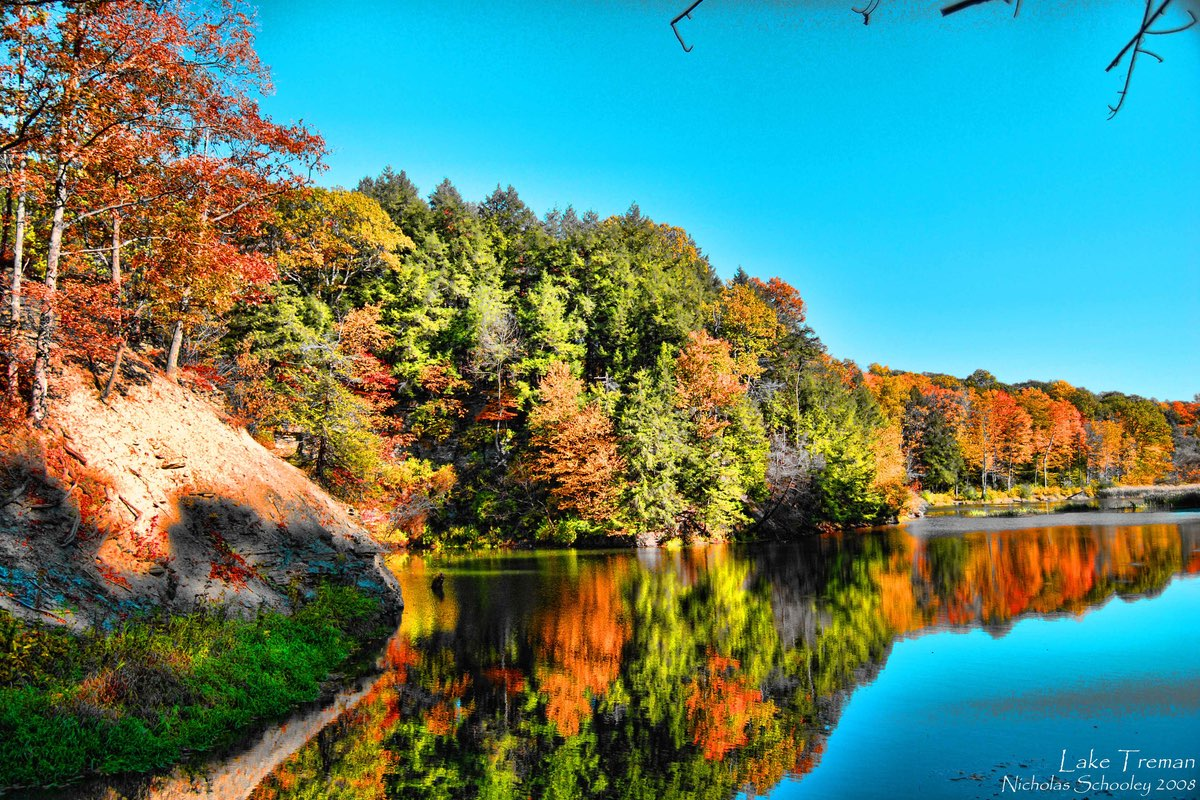 Fall foliage along Lake Treman in Buttermilk Falls State Park, New York.