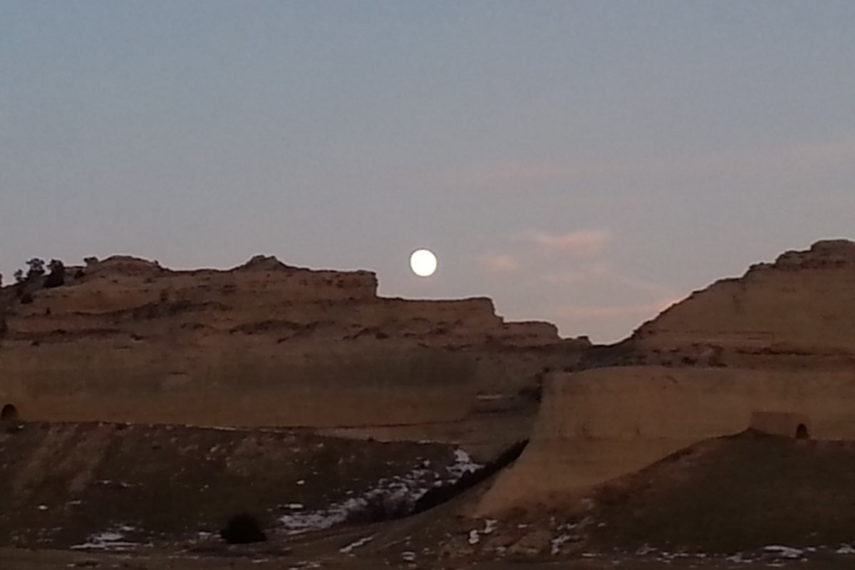 The moon rising over North Bluff in Scotts Bluff National Monument..