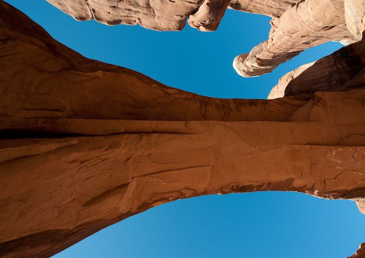 Looking up from underneath Tower Arch in Arches National Park.
