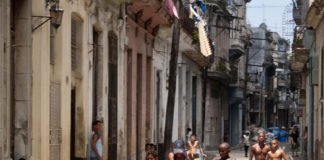 Kids playing street football in Havana.