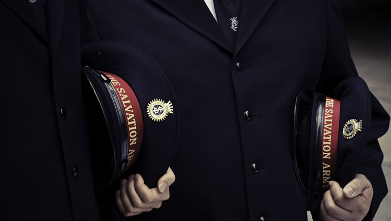 Two Salvation Army Officers standing with their uniforms