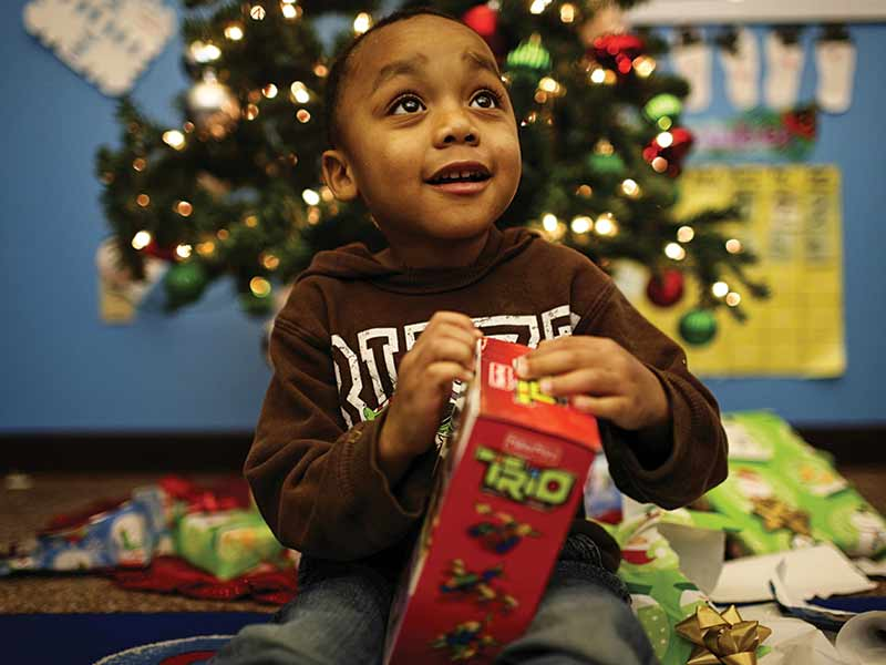 child with angel tree gift