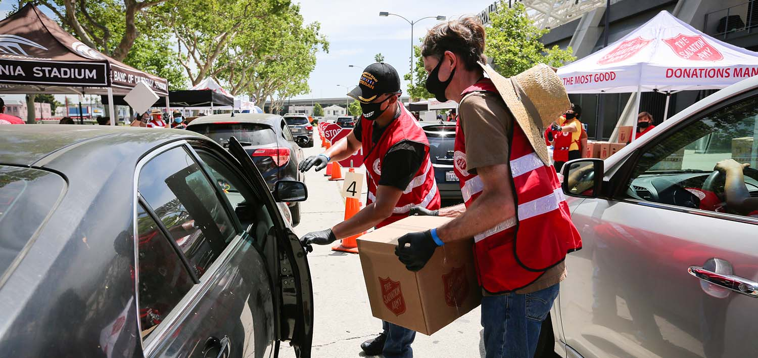 salvation army staff pack food bags for the community