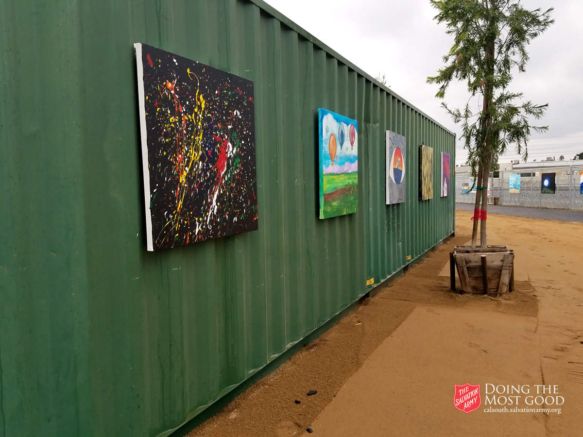 Artwork (painted canvas) line the shelter grounds