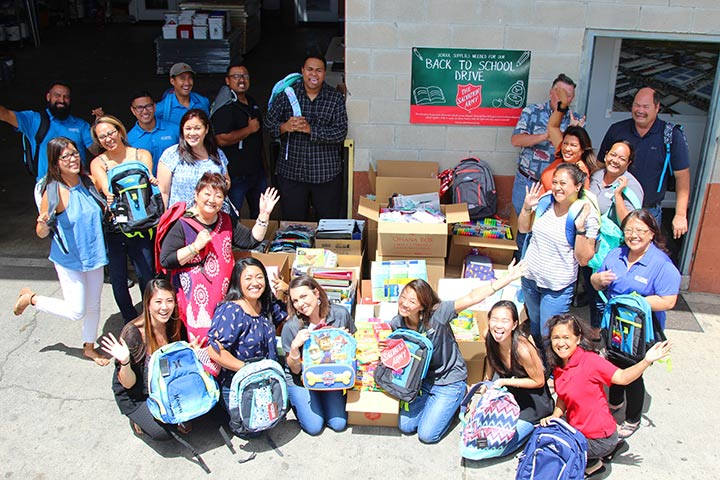 Group Photo of CRW staff with school supply donations