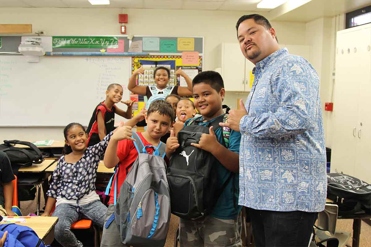 Salvation Army Echelon posing with Aiea Elementary Students
