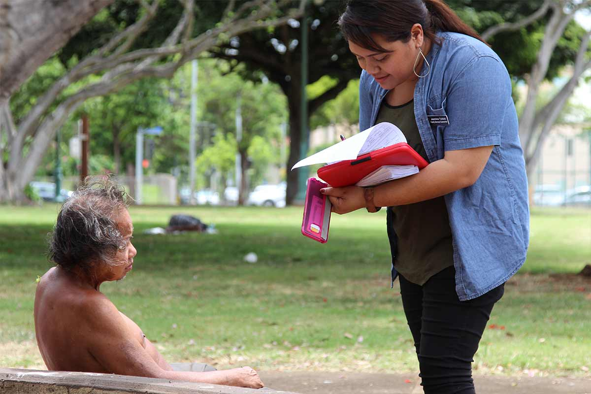 Salvation Army staff member speaking with homeless person