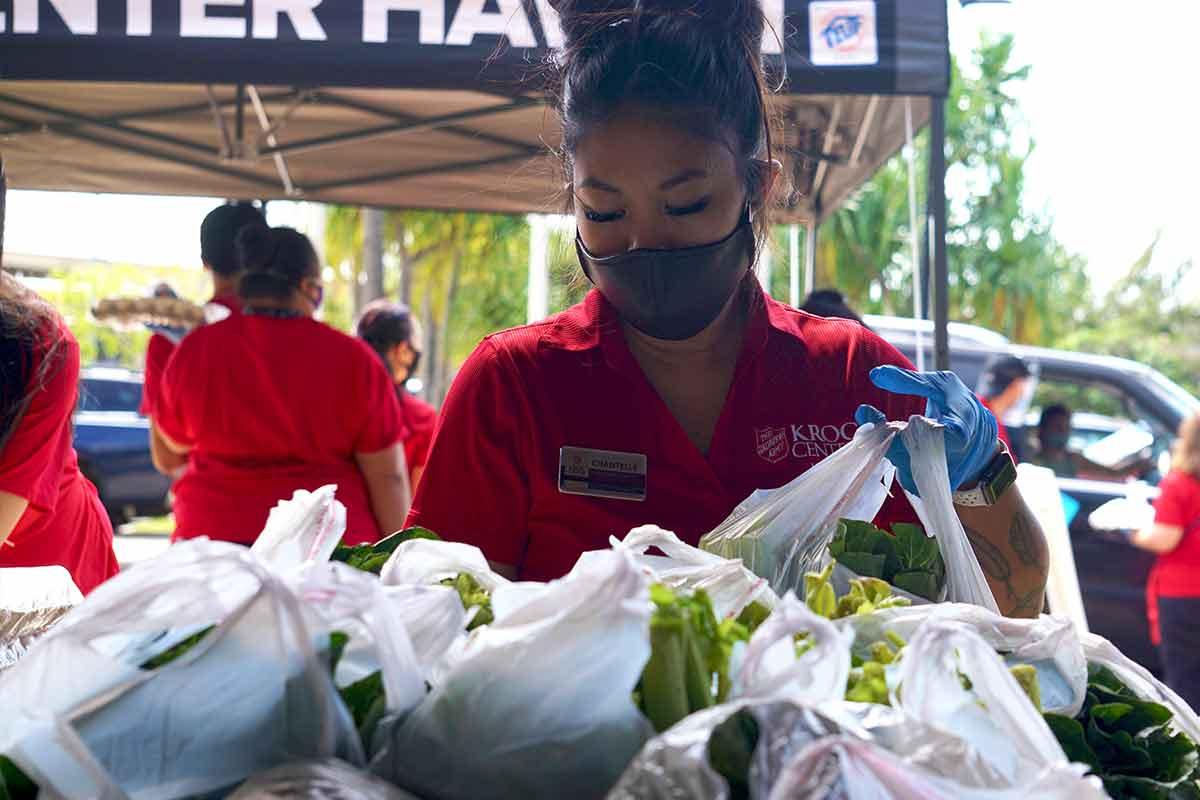 staff preparing food bags in covid relief