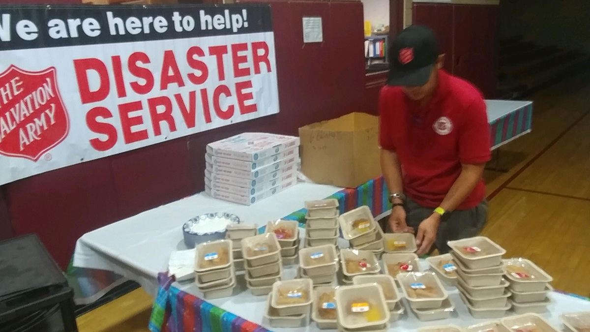 EDS Director serving food at evacuation shelter