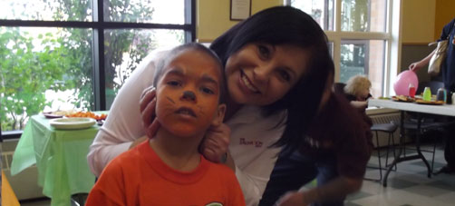 photo of child with face paint and Capt. Diana Gomes, Anchorage, 2013