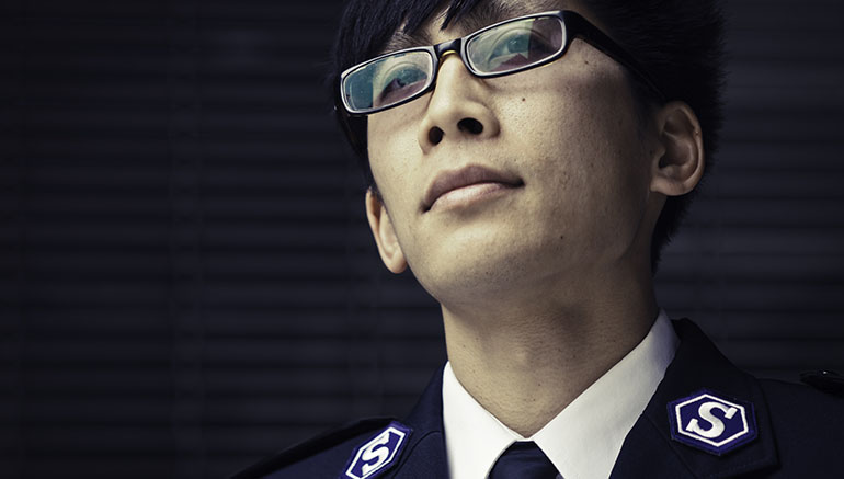 A Salvation Army Officer in uniform wearing glasses