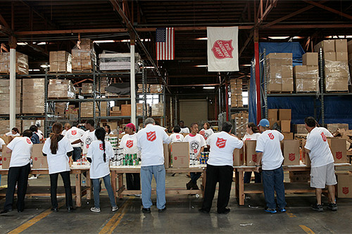 Volunteers pack food boxes.